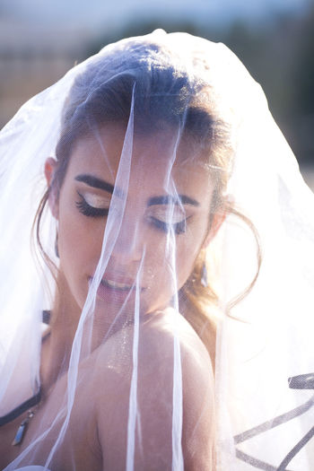 Close-up of bride wearing veil