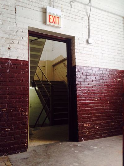 Architecture Built Structure Brick Wall Wall - Building Feature Building Exterior Closed Western Script Communication Text Door Information Sign Entrance Red Outdoors Day Exit Exit Sign Industrial