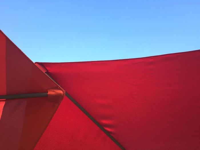 Low angle view of red built structure against clear sky