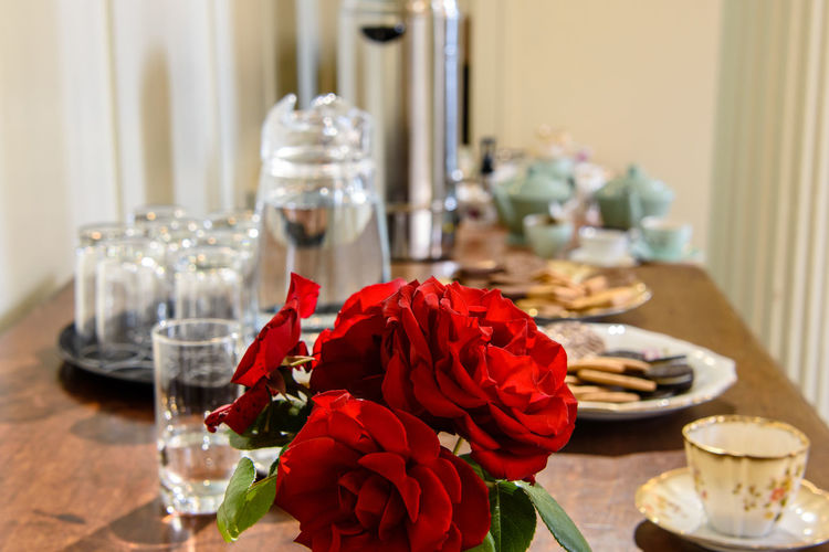 Refreshments for the volunteer workers. Red roses, tea and biscuits provided to make the volunteers feel appreciated. Glasses Volunteering Biscuits Close-up Flower Food And Drink Jug Jug Of Water Red Rose Refreshments For Sale Rosé Table Table Decoration Tea And Coffee Tea Cup Tea Cups And Saucers Vintage Tea Cups