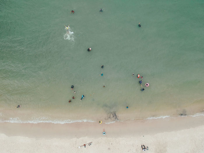 Drone shot from above the beach Beach Beauty In Nature Day Group Of People High Angle View Holiday Land Large Group Of People Leisure Activity Lifestyles Nature Outdoors Real People Scenics - Nature Sea Sport Trip Vacations Water The Minimalist - 2019 EyeEm Awards The Great Outdoors - 2019 EyeEm Awards