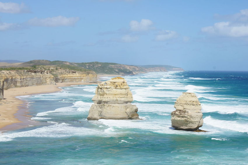 12 Apostles Australia Beauty In Nature Blue Cliff Cloud Cloud - Sky Coastline Day Great Ocean Road Horizon Over Water Idyllic Nature Outdoors Remote Rock Rock - Object Rock Formation Scenics Sea Shore Sky Tranquil Scene Tranquility Water