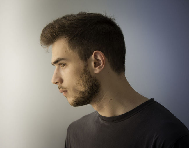 Portrait of young man looking away