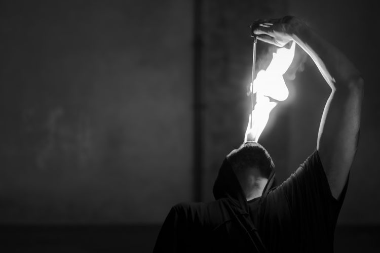 Kayo the illusionist (Parma, May 2018) Dark Flame Magical Man Parma Black And White Busker Fire Illusion Illusionist Magic Magician Mammal Night Portrait Streetphotography