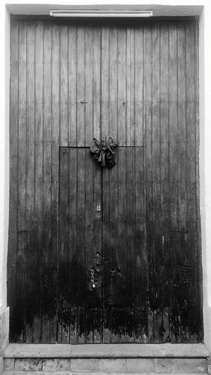 Wood - Material Closed Door Protection Outdoors Day No People Old-fashioned Architecture Black Ribbon