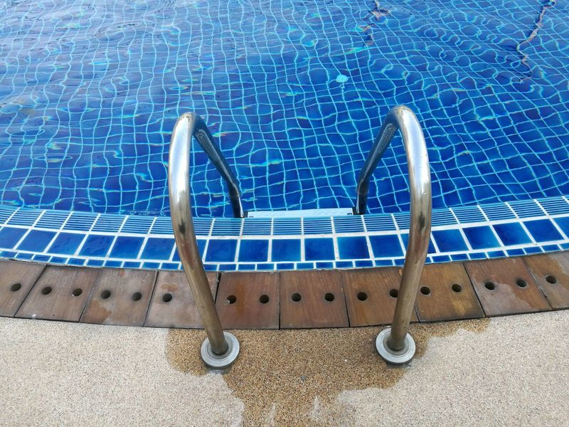 High Angle View Blue No People Swimming Pool Close-up Outdoors Day Water Pool Ladder Wet Floor Stainless Steel Metal
