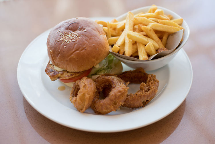 Grilled chicken burger with fries and onion rings American Bread Chicken Burger Close-up Cooked Diet Fast Food Food Food Styling Freshness Fries Grilled Hamburger Juicy Junk Food Lunch Meal Onion Rings Plate Ready To Eat Ready-to-eat Restaurant Serving Size Temptation Unhealthy Eating