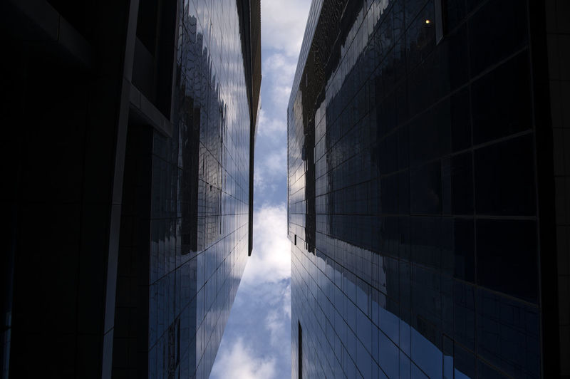 skyscrapers against sky in Gongdeokdong, Mapo, Seoul, South Korea Built Structure Architecture Building Exterior Building Sky Office Office Building Exterior No People Modern City Skyscraper Glass - Material Day Nature Cloud - Sky Outdoors Reflection Low Angle View Sunlight Window Pattern Directly Below