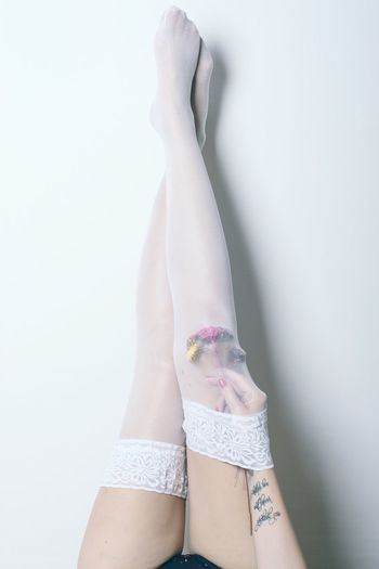 Flowers for the knee Stockings EyeEm Gallery Eye4photography  EyeEm Best Shots A New Beginning Human Body Part Body Part One Person Human Leg Adult Women Indoors  Lifestyles White Background Sock Real People Human Foot Fashion Copy Space A New Perspective On Life