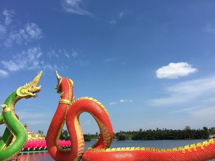 Nagas are facing each other. Cloud - Sky Statue Naga Thailand