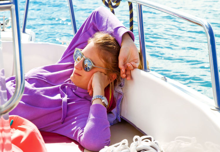 Young woman relaxing in boat
