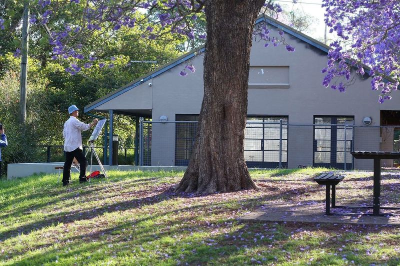Man walking on tree in front of building