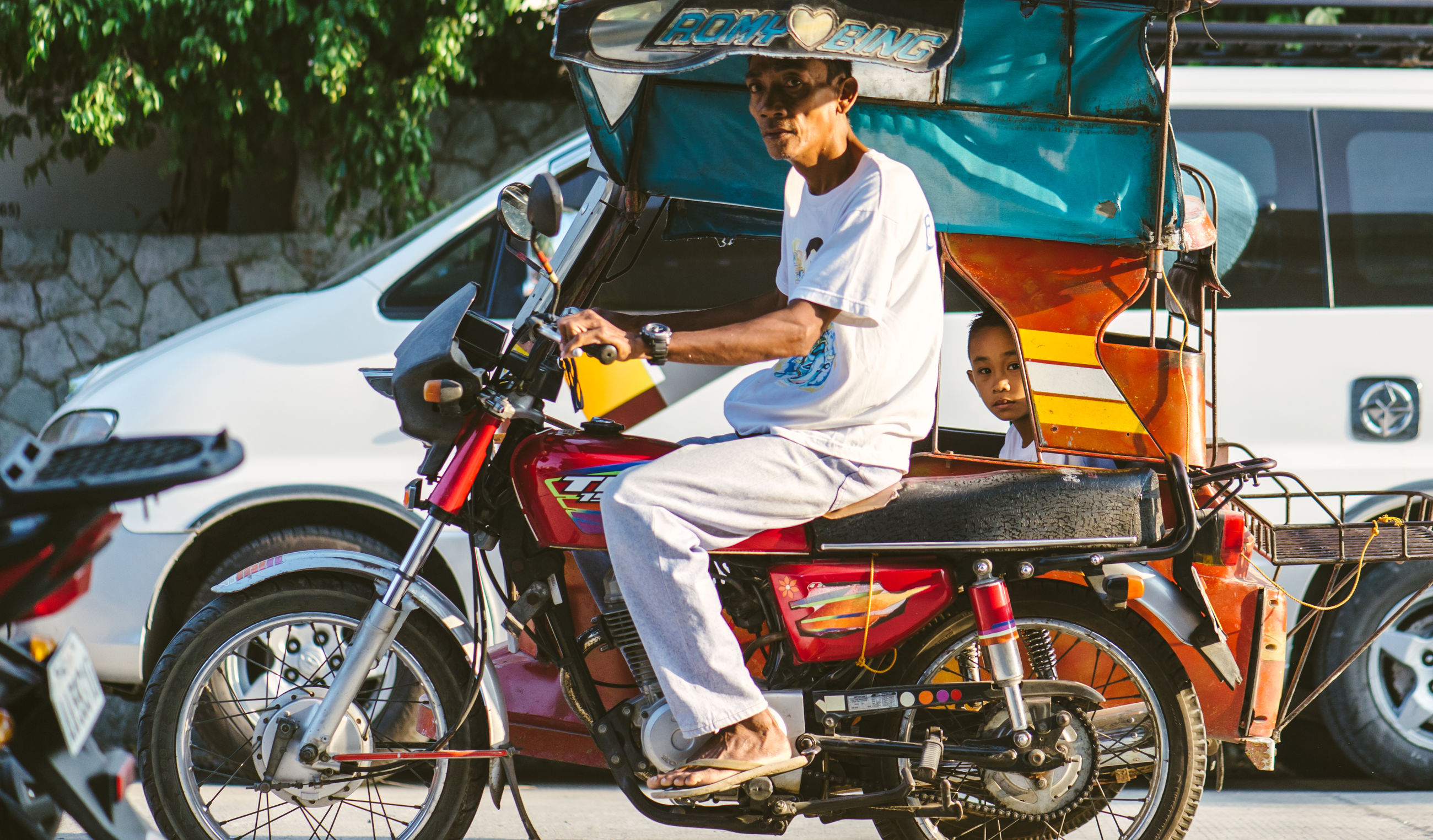 mode of transport, transportation, land vehicle, bicycle, riding, lifestyles, stationary, travel, leisure activity, motorcycle, car, street, parked, parking, men, on the move, casual clothing, cycling