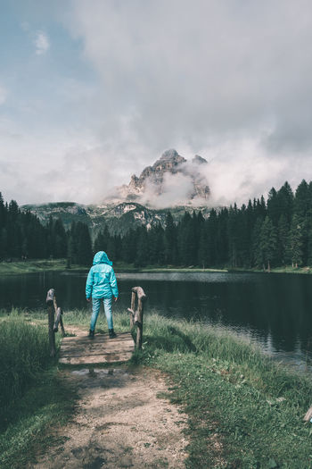 Girl in blue jacket looking up to the impressive Dolomites at Lake Antorno Antorno Blue Jacket Cloudy Colorful Jacket Dolomites Hiking Humble Italia Italy Jacket Lake Landscape Mountain Mountain View Mountains Outdoors Peaceful Peaceful View Raincoat Rainy Day Roaming Traveler Traveling Young Adult Young Women Finding New Frontiers