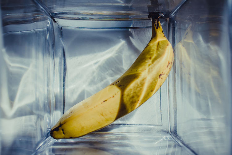 Banana magic Food And Drink Food Fruit Healthy Eating Wellbeing Banana Close-up Transparent Freshness No People Yellow Indoors  Glass - Material Ripe Peel SLICE Banana Peel Glass Studio Shot Tropical Fruit Plastic Bag Snack 17.62°