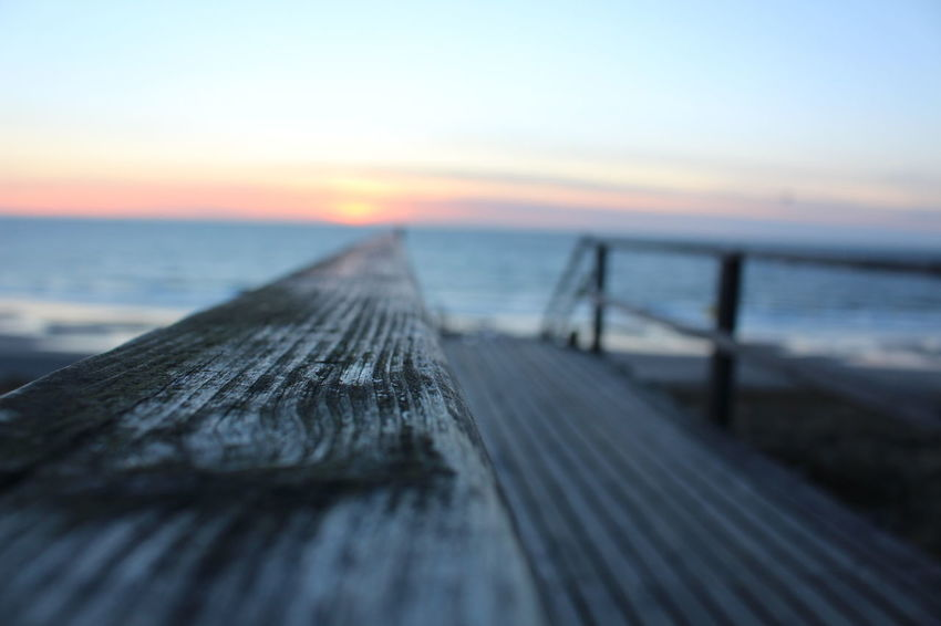 Beauty In Nature Close-up Day Horizon Over Water Jetty Nature No People Outdoors Pier Scenics Sea Sky Sunset Tranquility Water Wood - Material Wood Paneling