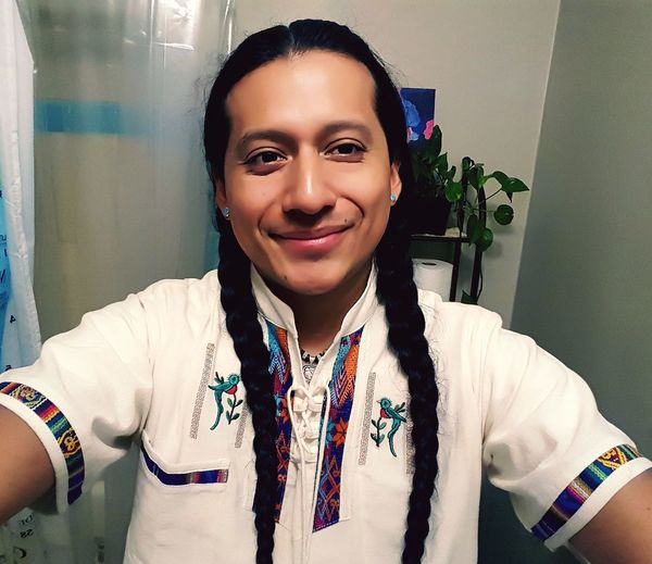 Tired, but felt very pleased to display my turquoise earrings, braids, and quetzal shirt for the first ever Indigenous People's Day in LA County. Indigenous  Indigenouspeoplesday Quetzal Chapin Peruvian Braids Long Beach California