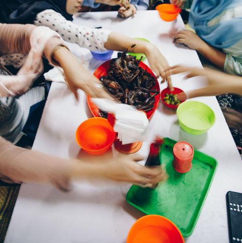 Boys Child Childhood Finger Food Food And Drink Group Of People Hand High Angle View Holding Human Body Part Human Hand Indoors  Leisure Activity Lifestyles Men People Playing Preparation  Preparing Food Real People Table