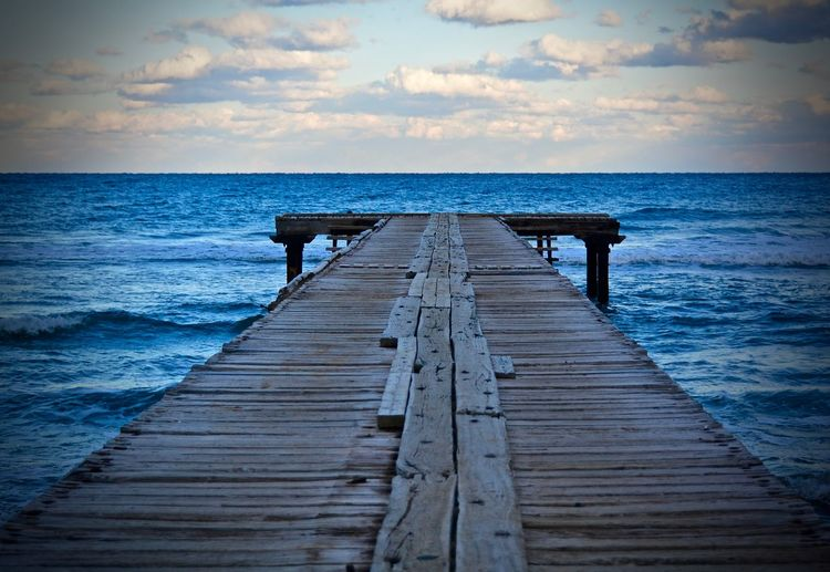 Wooden jetty leading to sea