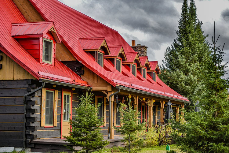 Old House . Architecture . Architecture Building Exterior Built Structure Coniferous Tree Day Hostel Log House Low Angle View No People Outdoors Red Red Roof Sky Timbered House Tree Tremblant Wood Construction