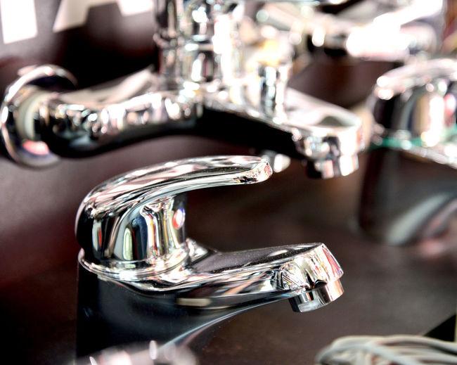 Close-up of metallic faucet