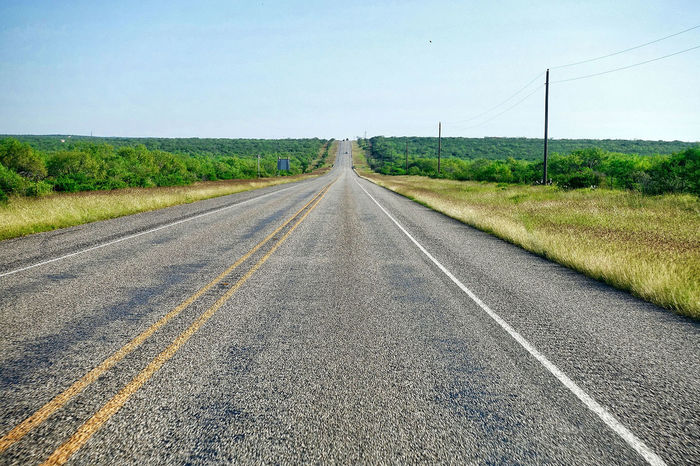 Flat bush land at Catarina in the USA. Catarina Clear Sky Grass Road Texas USA Asphalt Beauty In Nature Bushes Day Diminishing Perspective Landscape Nature No People Outdoors Plain Poles Scenics The Way Forward Tranquil Scene Tranquility Transportation Vanishing Point
