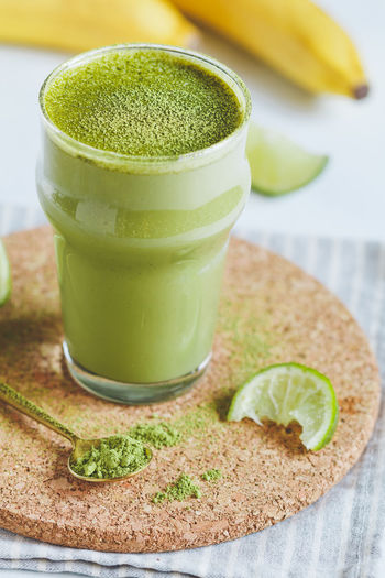 Close-up of green smoothie on table
