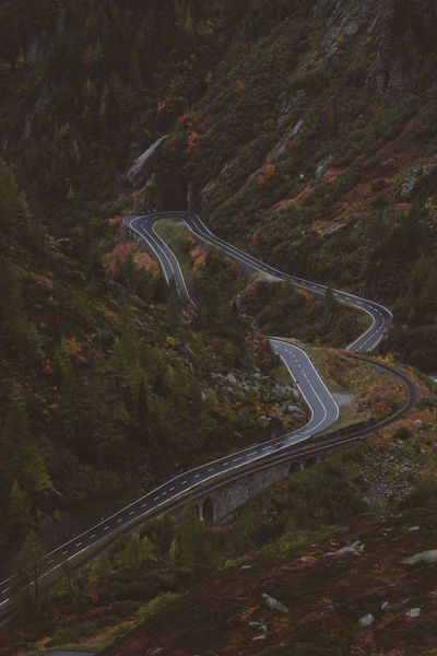 Road Transportation Curve No People High Angle View Connection Tree Nature Mode Of Transportation Plant Land Mountain Road Motor Vehicle Car Non-urban Scene Mountain Motion Beauty In Nature Winding Road on the move Outdoors Multiple Lane Highway Switzerland