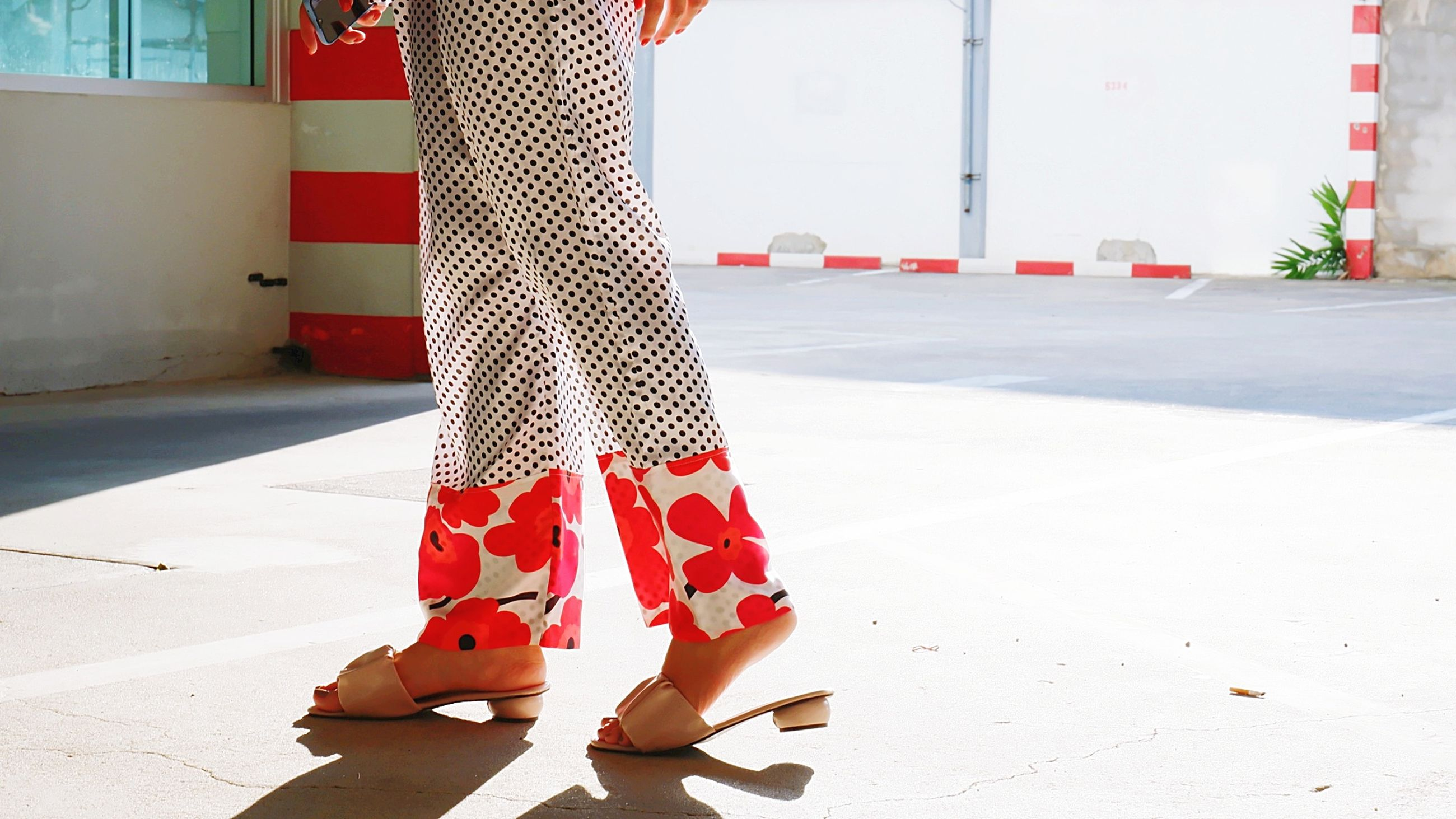 low section, red, human leg, one person, spring, footwear, shoe, pattern, adult, women, human limb, limb, standing, high heels, clothing, day, fashion, sunlight, outdoors, architecture, walking, shadow, nature, city, lifestyles, pantyhose
