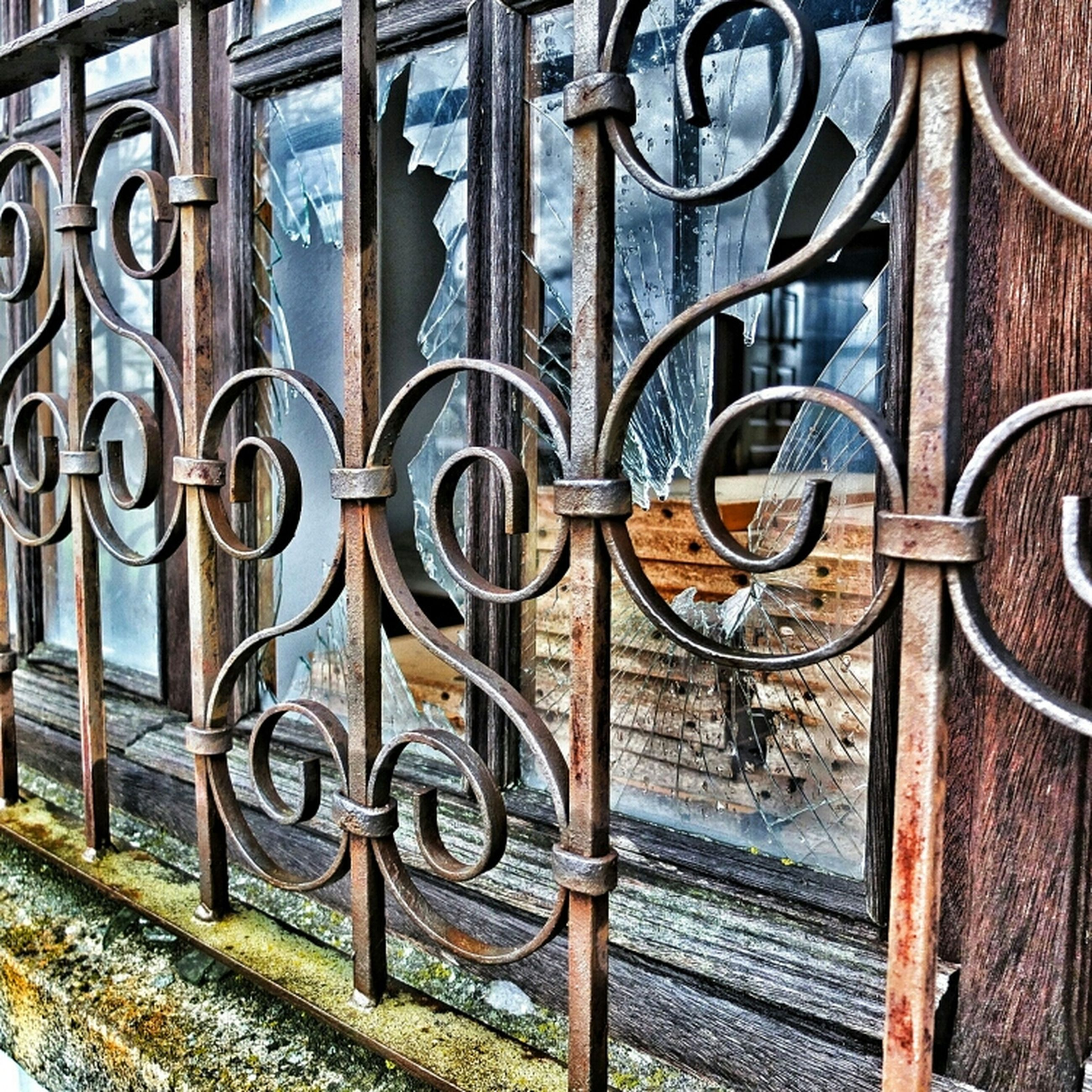 metal, built structure, architecture, building exterior, pattern, wall - building feature, gate, design, railing, protection, graffiti, safety, security, metallic, day, outdoors, no people, fence, bicycle, closed