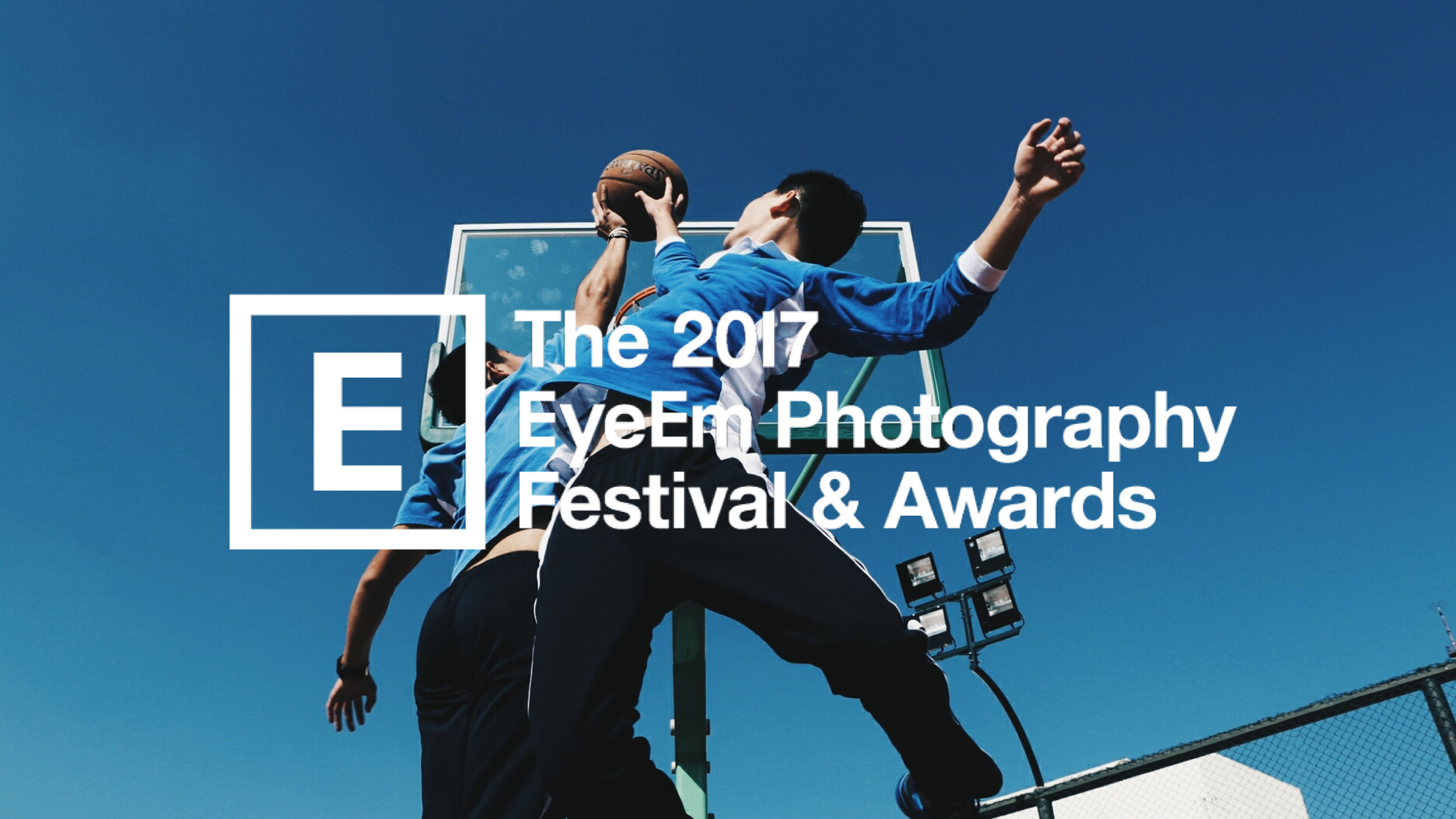 blue, text, low angle view, clear sky, communication, day, togetherness, men, outdoors, two people, real people, sky, people