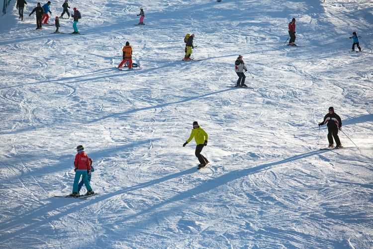 Low angle view of people on ski slope