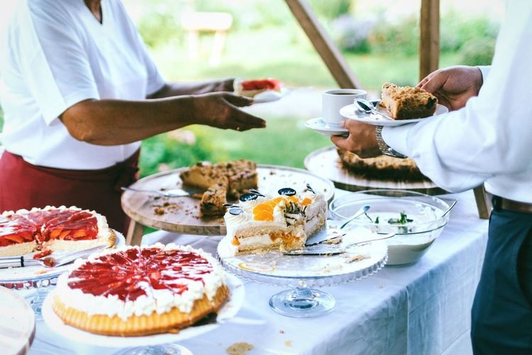 Variety of cakes 🍰 Food And Drink Food Plate Cake Real People Sweet Food Dessert Men Indulgence Temptation Ready-to-eat Freshness Midsection Two People Lifestyles Human Hand Human Body Part Sweet Pie Unrecognizable Person Wedding Wedding Reception Serving Food And Drinks Outdoors Variety Sweets