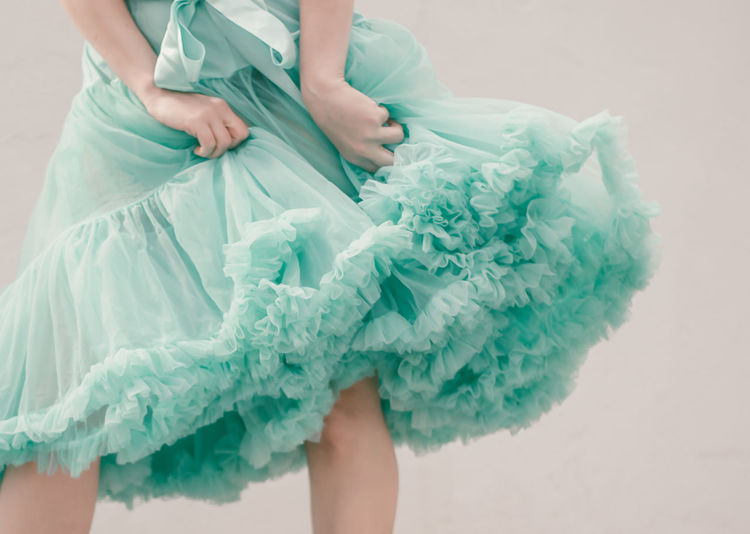 Midsection of woman with fluffy skirt