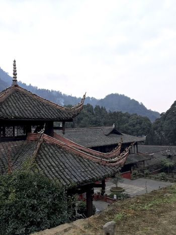 Architecture Beauty In Nature Buddhism Buddhist Temple Building Exterior Built Structure Chinese Clear Sky Day Hill History House Landscape Mountain Mountain Range Nature No People Outdoors Roof Scenics Sky Town Tranquil Scene Tranquility