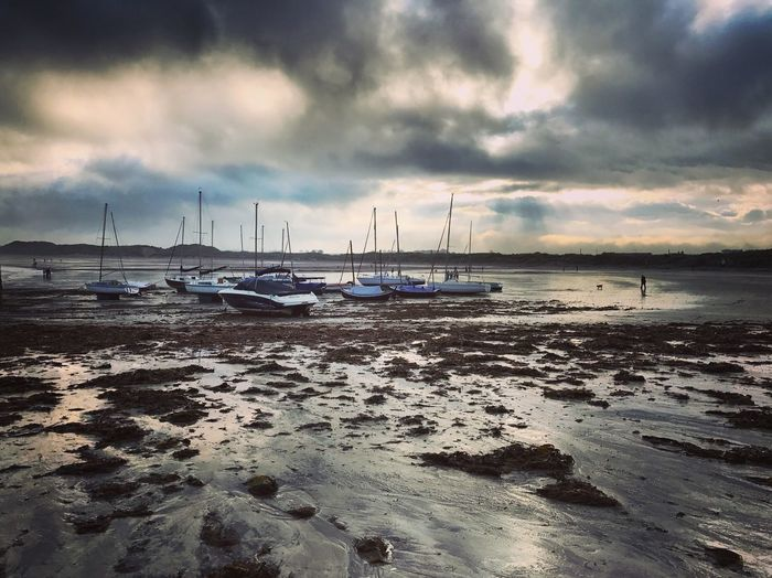 Water Sky Sea Cloud - Sky Sand Beach Nautical Vessel Nature Tranquility No People Scenics Tranquil Scene Outdoors Sunset Moored Transportation Beauty In Nature Horizon Over Water Day
