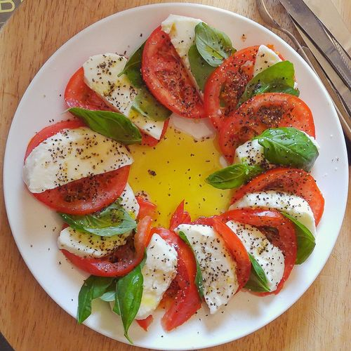 Close-up of caprese salad served on plate