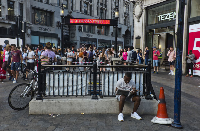People outside the underground station in Oxford Street on 9th of July 2018 in London, United Kingdom. Oxford Circus is a London Underground station serving Oxford Circus at the junction of Regent Street and Oxford Street and is the third busiest station in London. (photo by Lorenzo Grifantini) London Oxford Circus Transportation Tube Underground Adult City Crowd Group Of People Men Mode Of Transportation Outdoors Transportation