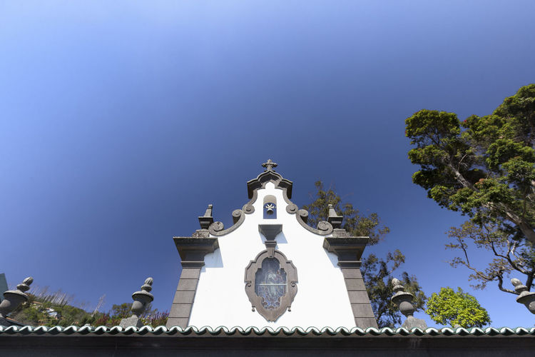 The Top of the Sancta Maria Chapel near the Jardim Tropical Monte Palace in Funchal. Architecture Botanical Gardens Church Funchal Jardim Tropical Monte Palace Madeira Madeira Island Portugal Portuguese Terrace Tourist Travel Trip Cobblestone Destination Explore Flower Iglesia Island Jardim Quinta Sancta Maria Chapel Summer Tourism Traditional