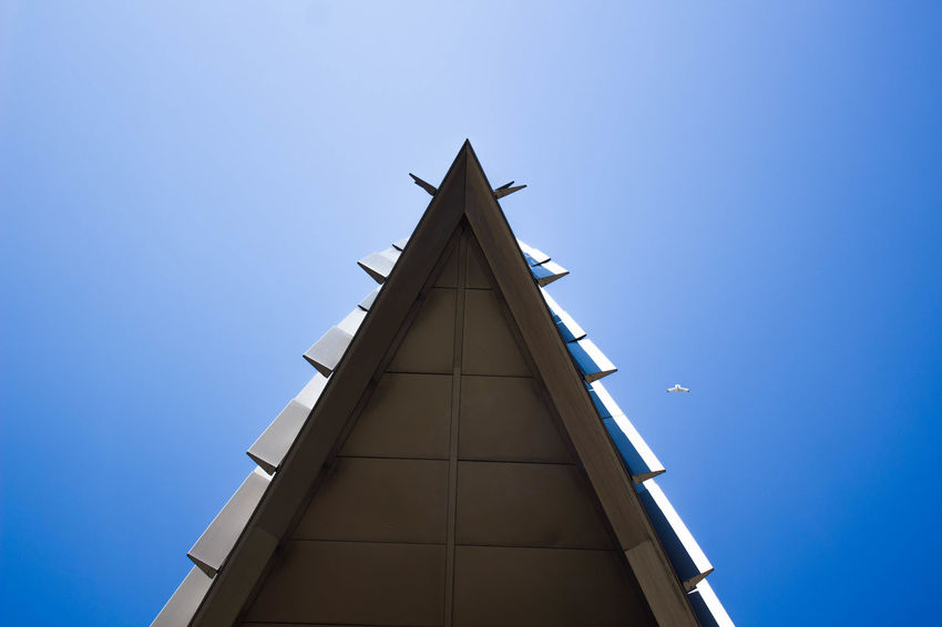 Shade Architecture Bird Blue Building Exterior Building Photography Built Structure Clear Sky Corner Day Geometric Low Angle View No People Outdoors Photo Sky