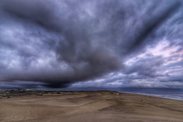 Scenic view of dramatic sky over beach