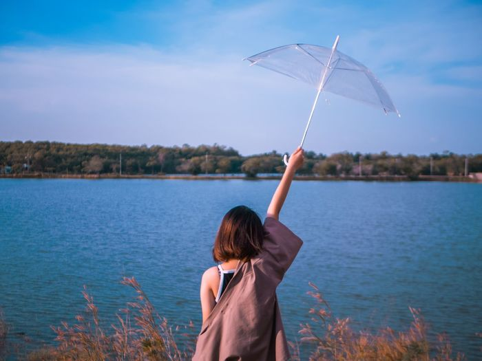 you can stay in my umbella Women Cloud - Sky Lake Sky Lifestyles Nature Beauty In Nature Outdoors Hairstyle Adult Hair Real People One Person Water Rear View Human Arm Day Leisure Activity Casual Clothing Holding Blue Kimono Umbrellas