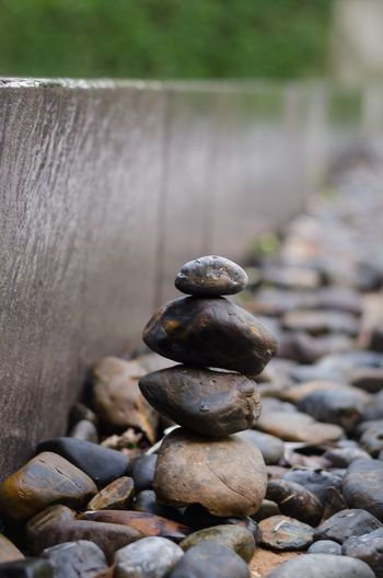 Close-up of stones stacked on land