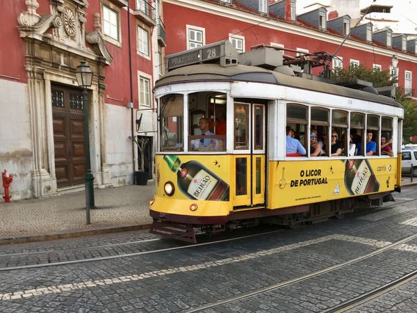 Tram in Lisbon, Portugal Capture The Moment City City Life Colors Lisboa Portugal On The Way Rails Tram Urban Lifestyle Way Of Life Building Exterior Day Land Vehicle Lisboa Mode Of Transport On The Road Outdoors Public Transportation Railroad Track Street The Way Forward Transportation Urban Yellow Mobility In Mega Cities Colour Your Horizn