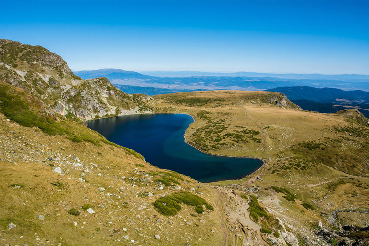 Seven Rila Lakes, Bulgaria The Kidney Бъбрека (Babreka) 2,282 m (7,487 ft) 8.5 ha (21 acres) 28.0 m (91.9 ft) Steepest shores of all Scenics - Nature Beauty In Nature Water Tranquil Scene Tranquility Non-urban Scene Blue Nature Sky Environment Mountain Day Lake No People Idyllic Landscape Land Mountain Range Outdoors Lake View Nature Nature_collection Nature Photography Beauty In Nature Beauty