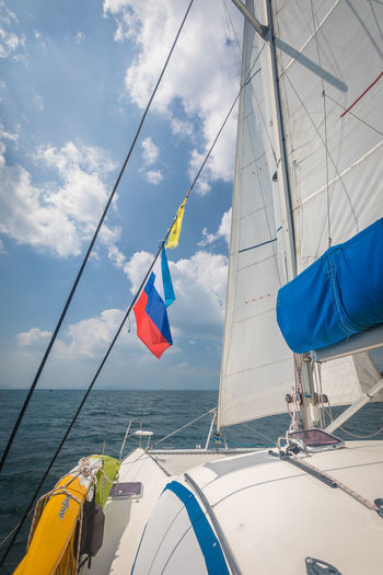 Water Transportation Sky Sea Nautical Vessel Mode Of Transportation Cloud - Sky Sailboat Day Nature Flag Patriotism Pole Sailing Rope Environment Wind Mast Outdoors Yacht