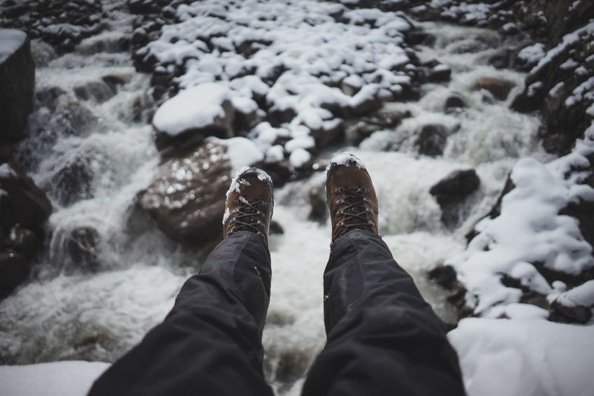 Sitting on a bride over a river Nature Explore Live Authentic Roaming Roam Outdoors Bridge Sitting Shoes Low Section Personal Perspective Human Leg Shoe Standing Winter One Person Real People Day Water Outdoors Nature Human Body Part Cold Temperature Close-up Pebble Beach People