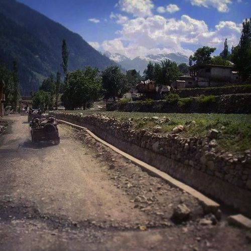 Army Jeeps Pakarmy in Beautiful swat valley nonmetalled roads lush green scenery distant snowy mountains trekking hiking tourism roadtrip evergreen trees naturelovers nature escapists heaven