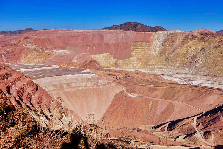 A part of the open pit copper mine at Morenci in the USA. Arizona Roads USA Blue Sky Day Dump Areas Landscape Morencicandles Mountain No People Open Pit Copper Mine Outdoors Step Walls