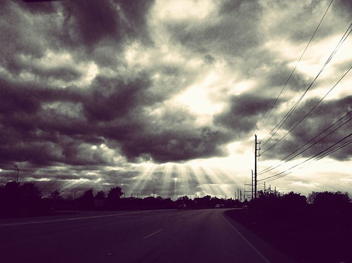 365 Grateful Project entry # 279: Yesterday was an emotionally-draining day. But this is what I saw from the car while on the road. It lightened my heart. Whim_Wednesday Blackandwhite Photography Clouds Clouds And Sky Light And Dark Shafts Of Light Shafts Of Sunlight Rays Of Sunlight Sun Rays, Dark Clouds Hope Trust Keep The Faith Don't Lose Heart Rays Of Hope